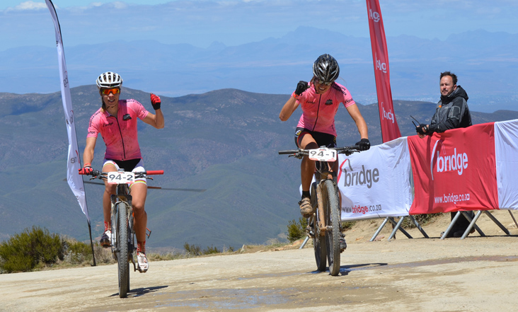 Anika Langvad (left) and Ariane Kleinhans celebrate winning Stage 2 of the 2013 Bridge Cape Pioneer Trek. They have confirmed they will defend their women's title at the 2014 edition of the international stage race. Photo credit: Zoon Cronje/Nikon/XtreMedia