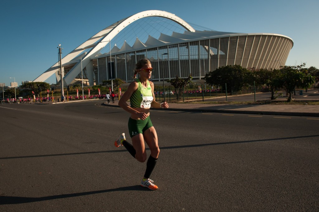 Irvette Van Zyl (Nedbank Running Club) claimed gold at the 10km Totalsports Ladies Race in Durban on Sunday, 20 July 2014 crossing the finish line at Berea Rovers Sports Club in an impressive time of 33 minutes 49 seconds.  PHOTO CREDIT:  Cherie Vale / NEWSPORT MEDIA