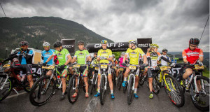 The category leaders prepare to start the final stage of the 2014 Bike Transalp. South African Andrew McLean (third from left) and his Austrian teammate, Heinz Zorweg, wear the green Grand Master leader jerseys.