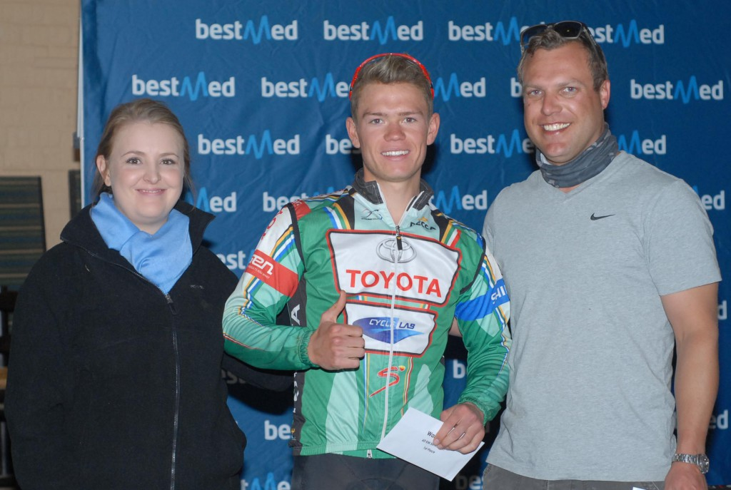 Bestmed Walkerville Mountain Bike Classic winner Kallen Williams (centre) shows his delight as he receives his prize from Bestmed marketing team member Ferri Erasmus and route director Darren Herbst on Sunday. Photo: Jetline Action Photo