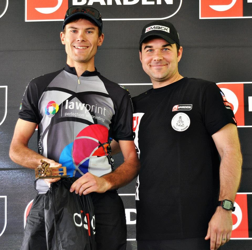 Men's solo category winner Dylan Rijnberg (left) receives his trophy from Barden Tyres' Thomas Rundle at the Pretoria Boys High School 24-Hour Mountain Bike Challenge last weekend. Photo: Supplied
