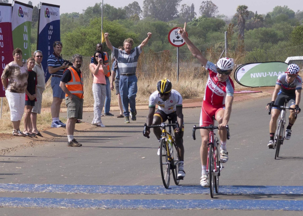Bonitas sprinter Herman Fouché (second from right) celebrates his third successive victory at the Bestmed Campus2Campus SuperClassic in Potchefstroom on Sunday. Tesfom Okbamariam (left) of the MTN-Qhubeka feeder team was second, followed by Tyler Day of Westvaal-BMC in third. Photo: Mario van de Wall