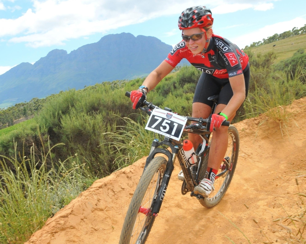 Seen here:  Amy Williams (17) of Knysna in action at the 2013 Pennypinchers Origin Of Trails 2-Day Mountain Bike Stage Race.  PHOTO CREDIT:  Jetline Action Photo