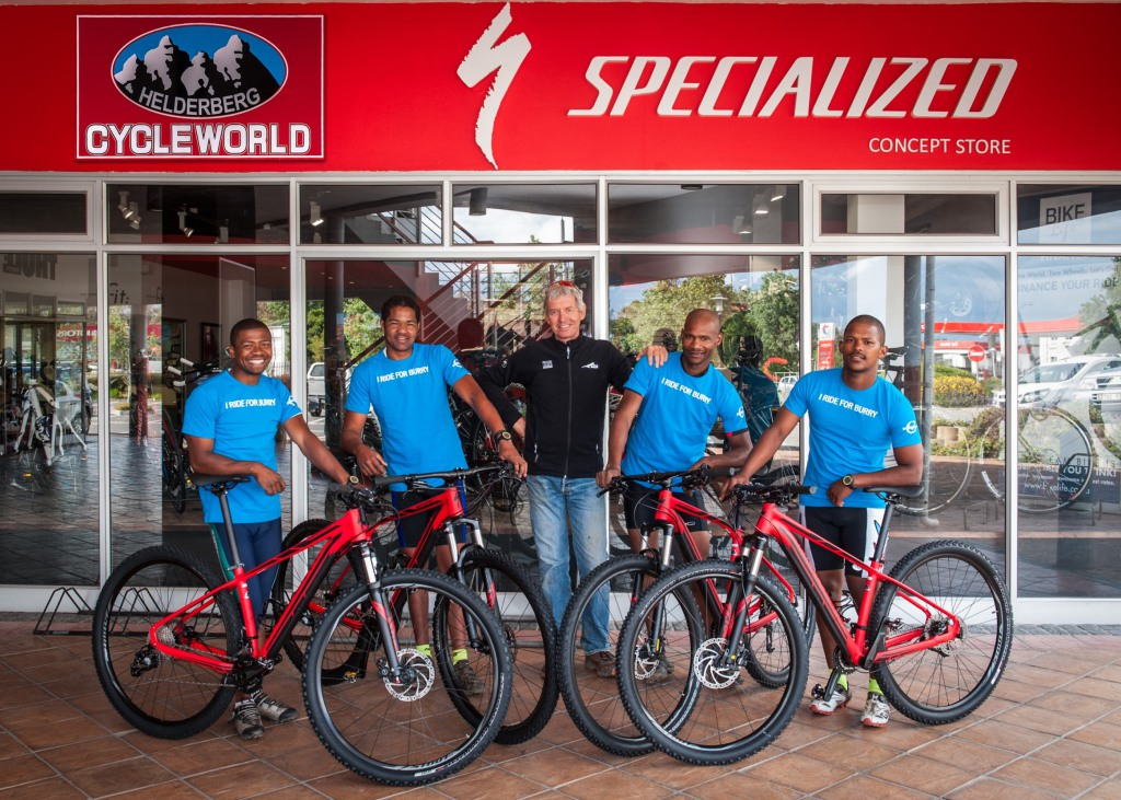 "Cape Trails, the official route builders of the FNB Wines2Whales (W2W) Mountain Bike (MTB) Events, are super excited to take ownership of their new Specialized mountain bikes compliments of the FNB W2W event organizers and Specialized South Africa.  Seen here (from left to right):  Ashwell Swartz, Jason Adams, Johan Kriegler (FNB W2W MTB Director), Denzel Scheepers and Brendon Booysen.  PHOTO CREDIT:  Cherie Vale / NEWSPORT MEDIA  Please Note:  The ""I RIDE FOR BURRY"" t-shirt worn by Cape Trails in the attached photograph retails at R150 and will be available at the Specialized/songo.info display at the 2014 FNB W2W MTB Events."