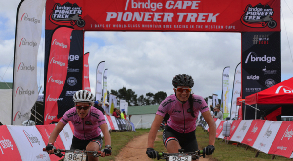 Catherine Williamson (left) and Alice Pirard (Asrin Cycling) show their joy at retaining their overall women's race lead on Stage 5 of the Bridge Cape Pioneer Trek. Photo credit: Zoon Cronje/Nikon/Xtremedia