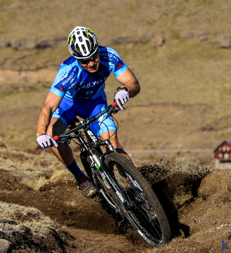 Armand du Toit carving up the single track. Photo credit: Jason May | Location - Afriski. Kapoko Mountain Bike Park.