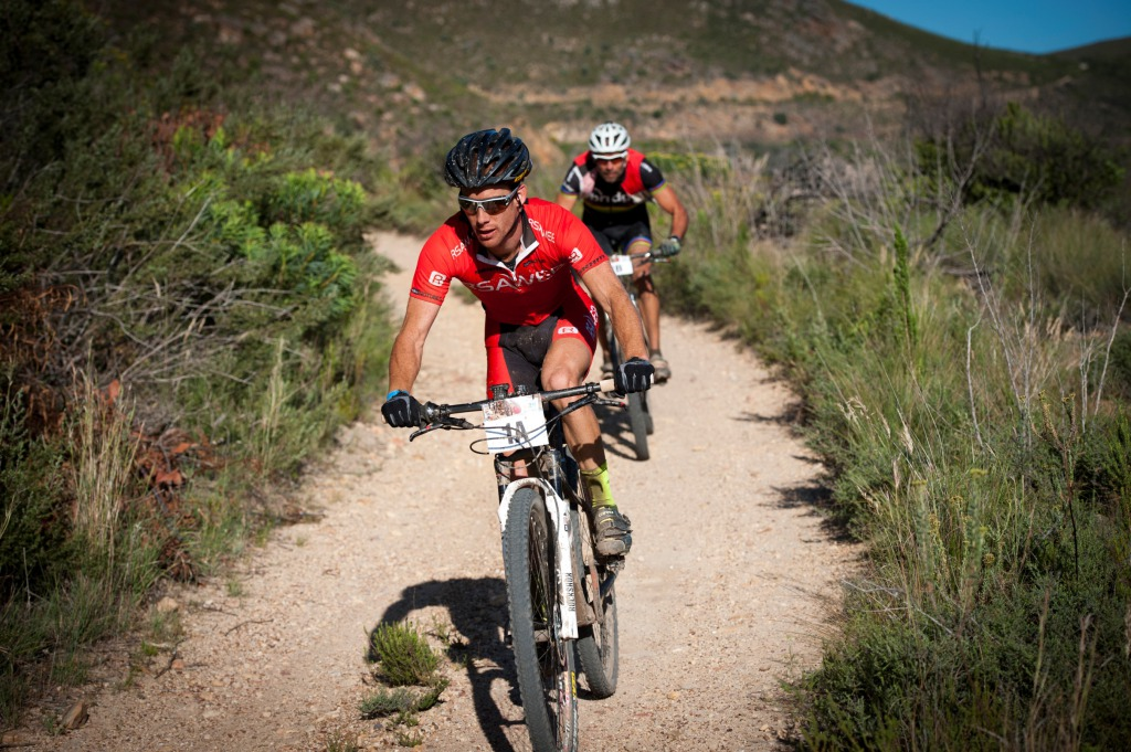 Seen here (front to back):  Renay Groustra and Nico Pfitzenmaier in action at the 2013 FNB Wines2Whales (W2W) Mountain Bike (MTB) Race.  Photo Credit:  Cherie Vale / NEWSPORT MEDIA
