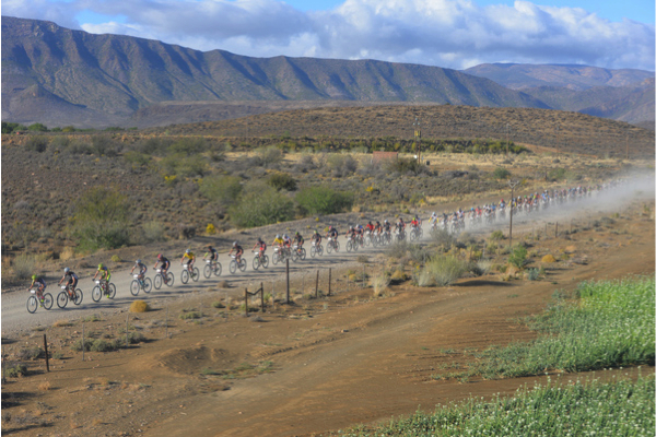 The field of over 400 riders is stretched out under the fast early pace during the opening kilometres of Stage 3 of the Bridge Cape Pioneer Trek. Photo credit: Zoon Cronje/Nikon/Xtremedia