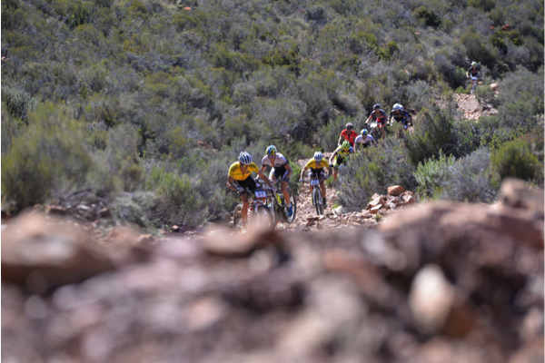 In keeping with tradition, the terrain of the 2014 Bridge Cape Pioneer Trek is unforgiving. The leaders tackle a loose, rocky climb during Stage 3 on Wednesday. Photo credit: Zoon Cronje/Nikon/Xtremedia