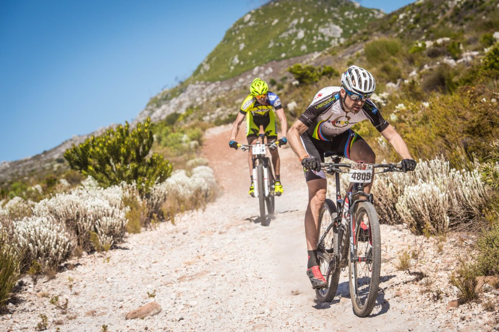 Christoph Sauser and Konny Looser of Team Meerendal-SONGO-Specialized/Wheeler claimed the Stage One victory at the FNB Wines2Whales (W2W) Mountain Bike (MTB) Race on Friday, 07 November 2014 crossing the finish line first in an awe-inspiring time of 03 hours 09 minutes 34 seconds.  Seen here (front to back):  Christoph Sauser and Konny Looser in action on the day.  Photo Credit:  Volume Photography