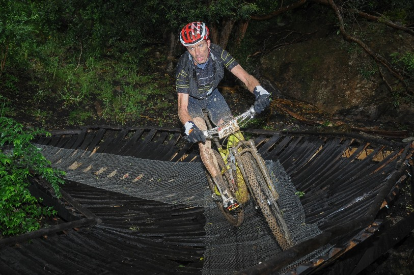 Seen here:  Frikkie Hartog of Team Knersus in action on the infamous Pofadder section of the Stage Two route of the FNB Wines2Whales MTB Ride on Tuesday, 04 November 2014.  Photo Credit:  Jetline Action Photo