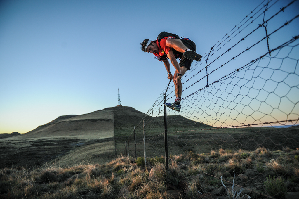 all winner Iain Don-Wauchope crosses a farm fence on his way to a record-breaking victory. (c) Trautman/Nikon/Lexar