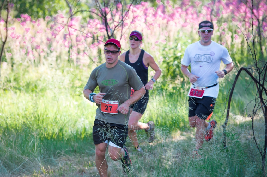 Seen here:  Participants enjoying the Totalsports XTERRA trail run routes in 2013.  PHOTO CREDIT:  Volume Photography