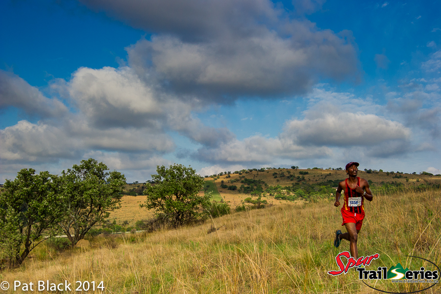 Edwin Sesipi on his way to victory at race 4 of the Spur Gauteng Summer Trail Series™ 2014. Image by Pat Black