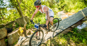 Bradley Weiss claimed a long overdue victory in the men's race at the TOTALSPORTS XTERRA Buffelspoort Full presented by REHIDRAT® SPORT at Buffelspoort Dam (North West Province) on Saturday, 24 January 2015 completing the 1.5km swim, 26.5km mountain bike discipline and 12km trail run in a lighting fast combined time of 02 hours 35 minutes 31 seconds.  Seen here:  Weiss in action on the mountain bike discipline.  Photo Credit:  Volume Photography