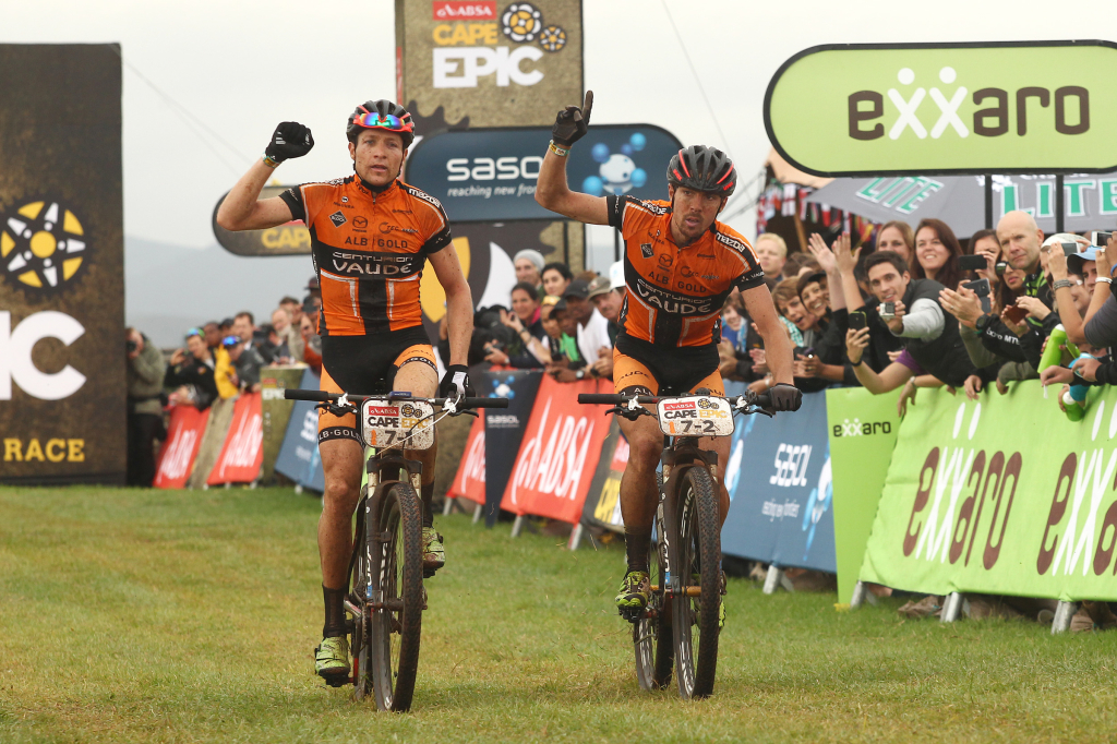 Markus Kaufmann and Jochen Kaess of Centurion-Vaude celebrate as they cross the line to win stage 1 during stage 1 of the 2014 Absa Cape Epic Mountain Bike stage race held from Arabella Wines in Robertson, South Africa on the 24 March 2014 - Photo by Shaun Roy/Cape Epic/SPORTZPICS