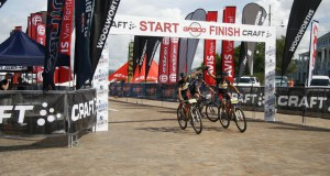 OVERALL TEAM WINNERS, MAX KNOX AND KEVIN EVANS, TEAM BIOGEN-VOLCAN, CROSSING THE FINISH LINE