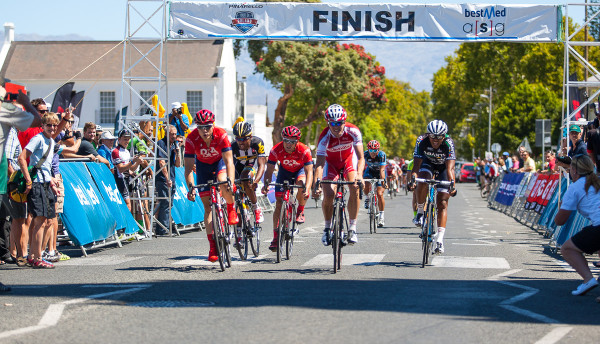 Bonitas's Herman Fouche (second from right) hits the finish line ahead of Drapac's Brenton Jones (far left) and Abantu's Nolan Hoffman (right) to claim the first stage of the 2015 Bestmed Tour de Boland in Worcester on Monday. Photo: Capcha Photography