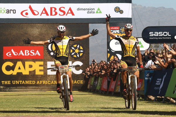Race leaders Christoph Sauser and Jaroslav Kulhavy of Investec-Songo-Specialized celebrate winning stage 3 and their 3rd stage victory of this years race during stage 3 of the 2015 Absa Cape Epic Mountain Bike stage race held from Oak Valley Wine Estate in Elgin to HTS Drostdy in Worcester, South Africa on the 18 March 2015 - Photo by Shaun Roy/Cape Epic/SPORTZPICS