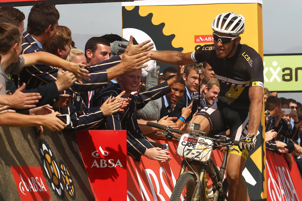 Matthys Beukes of Scott Factory Racing celebrates with school learners after winning the 111km Stage 4 with Partner Philip Buys. during stage 4 of the 2015 Absa Cape Epic Mountain Bike stage race from HTS Drostdy in Worcester, South Africa on the 19 March 2015 - Photo by Shaun Roy/Cape Epic/SPORTZPICS