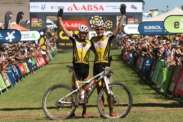 Christoph Sauser of Investec-Songo-Specialized and Jaroslav Kulhavy of Investec-Songo-Specialized celebrate winning the 2015 Absa Cape Epic during the final stage (stage 7) of the 2015 Absa Cape Epic Mountain Bike stage race from the Cape Peninsula University of Technology in Wellington to Meerendal Wine Estate in Durbanville, South Africa on the 22 March 2015 - Photo by Shaun Roy/Cape Epic/SPORTZPICS