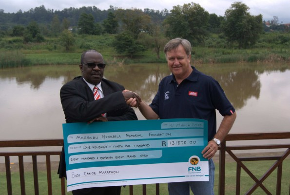 General Manager of the Dusi Canoe Marathon Brett Austin Smith hands over the cheque of R131 878 to Todani Moyo, representative for the Ntombela Player Memorial Fund, following a hugely successful Dr Player Memorial Charity Batch Bidding process in the build up to the 2015 Dusi Canoe Marathon.  - Nick Tatham/ Gameplan Media