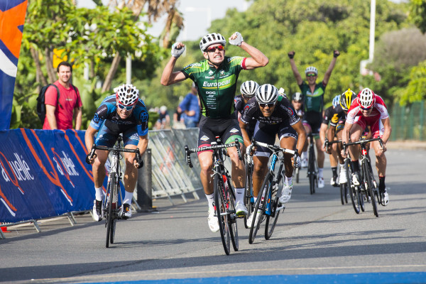 Ryan Gibbons (Europcar) celebrates winning the aQuellé Tour Durban presented by Sunday Tribune from Tyler Day (Westvaal) and Nolan Hoffman (Abantu). - Anthony Grote/ Gameplan Media