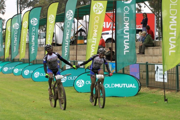 RMB Change a Life Academy riders Sthembiso Masango and Mboneni Ngcobo celebrate as they cross the finish line at Frankfort on the neutral opening stage of the nine-day Old Mutual joBerg2c on Saturday. Photo: Full Stop Communications