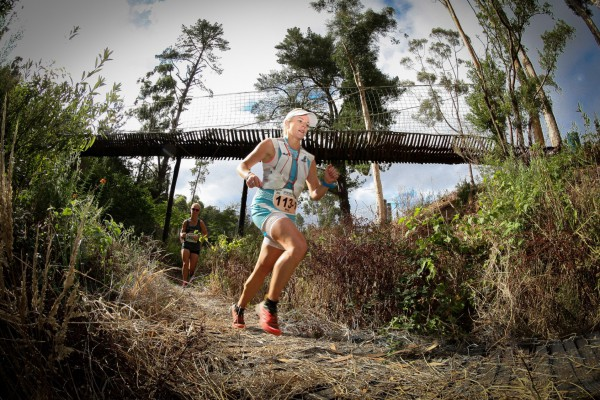 Seen here:  Megan Mackenzie in action at the 2015 ProNutro AfricanX Trailrun presented by New Balance.  PHOTO CREDIT:  Jetline Action Photo