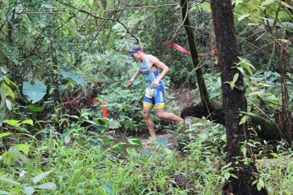 Navigating my way through the muddy trails on the run leg