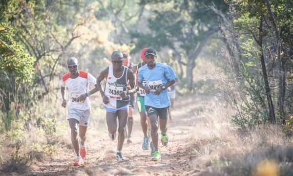 Lucky Miya claimed victory in the men's 24km FNB Platinum Trail Run at the ATKV Buffelspoort on Sunday, 24 May 2015 in an impressive time of 01 hours 29 minutes 16 seconds.  Seen here (from left to right):  Thabang Madiba, Ngwendu Mziwnke and Lucky Miya in action on the day.  PHOTO CREDIT:  Volume Photography