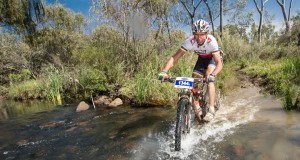 Seen here:  Nico Pfitzenmaier on his way to victory at the 2014 FNB Magalies Monster MTB Classic presented by ISUZU at ATKV Buffelspoort  (North West Province).  Photo Credit:  Volume Photography