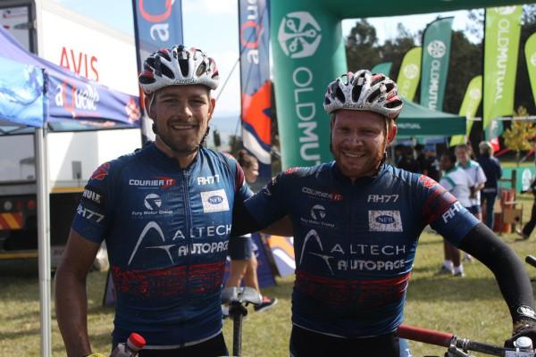 Pieter Seyffert (left) and Hanco Kachelhoffer of Altech Autopage Karan Beef celebrate their first stage win on day seven of the nine-day Old Mutual joBerg2c near Ixopo on Thursday. Photo: Full Stop Communications