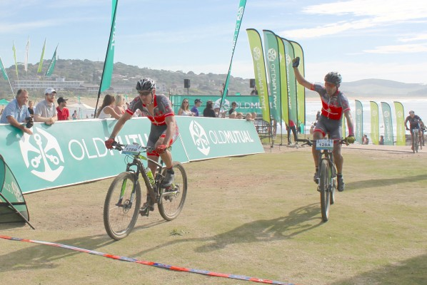 EAI Cycling's Johann Rabie (left) and Gawie Combrinck celebrate their victory in the nine-day Old Mutual joBerg2c mountain bike race on Saturday. The event followed a 900km route from Heidelberg, just south of Johannesburg, to Scottburgh on the KwaZulu-Natal South Coast. Photo: Full Stop Communications