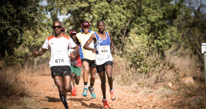 Seen here:  Thabang Madiba (race number 676) in action at the 2014 FNB Platinum Trail Run at the ATKV Buffelspoort  (North West Province) in 2014.  Photo Credit:  Volume Photography