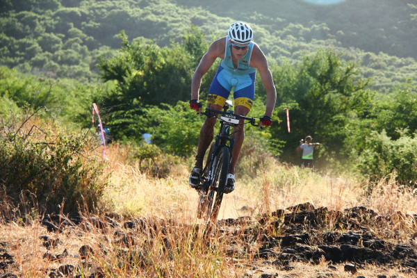 Theo Blignaut charging the bike course. Photo Credit: Michka Photography