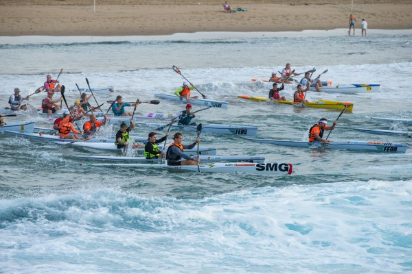 Paddlers head out through Scottburgh's surf early on Sunday morning at the start of the Halfway Toyota Scottburgh Classic, race one of the 2015 FNB Durban Downwind Surfski Series. - Topfoto/ Gameplan Media