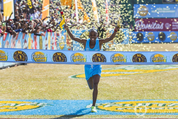 Gift Kehele winning the 2015 Comrades. Photo Credit: Kierran Allen