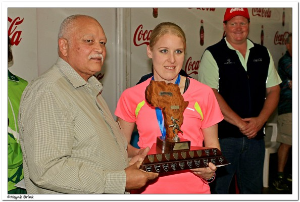 The women open in the 2014 Voet van Afrika marathon was won by Candyce Hall (Carbineers) in 3:18:51. Ursula Frans (NBMCWP) in 3:21:41 was second and Suzette Vermaak (NEDWP) in 3:26:47 third. Hall received her trophy from Cllr Richard Mitchell, Executive Mayor of Cape Agulhas Municipality. Photo: Heyne Brink, Mega Media
