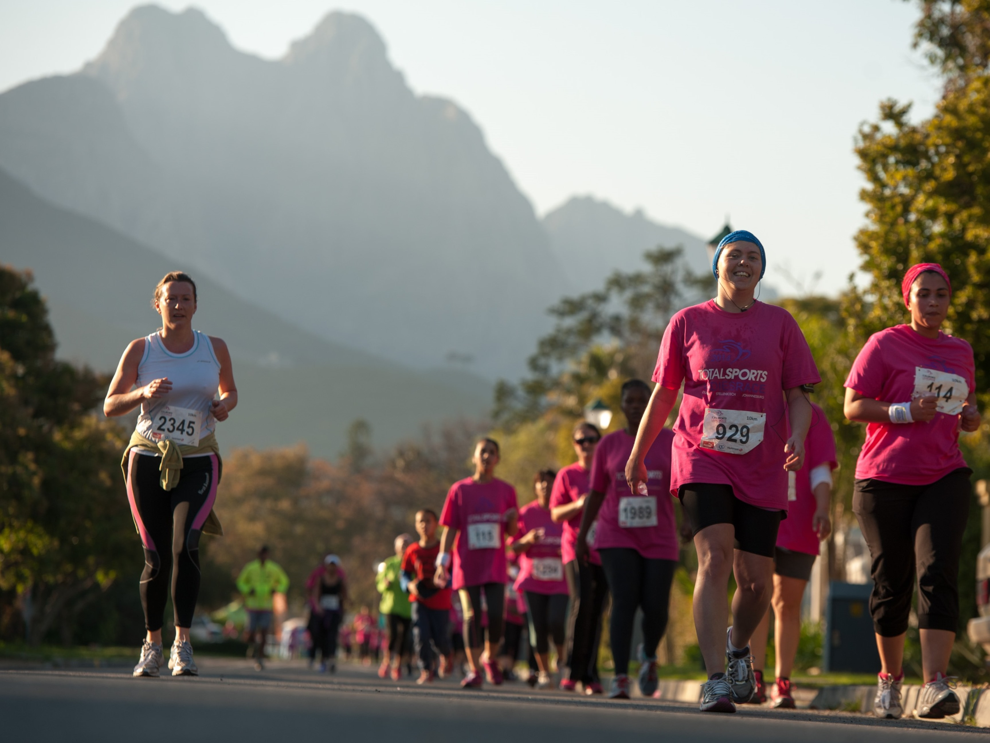 Runners and Walkers in action at the 2014 Totalsports Women's Race in Stellenbosch.  PHOTO CREDIT:  Cherie Vale / NEWSPORT MEDIA