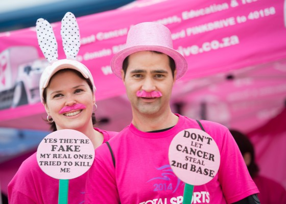 Participants at the 2014 Totalsports Women's Race in Stellenbosch show their support of PINKDRIVE.  Photo Credit:  Cherie Vale / NEWSPORT MEDIA