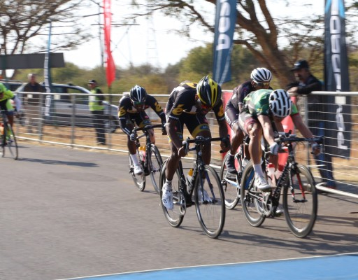 Ryan Gibbons (right) edges out runner-up Meron Teshome (left) and third-placed Nolan Hoffman (obscured) to take the win in the Powerade Lost City Cycle Classic, presented by Bestmed, at Sun City on Saturday. Photo: Rika Joubert/Cycle Nation