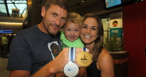 Six times marathon canoeing world champion Hank McGregor is welcomed home at King Shaka International airport by his one year old son Thorsten and his wife Pippa, after picking up a Men's K1 gold and K2 silver medal with Jasper Mocké at the world championships in Győr, Hungary. Dave Macleod/ Gameplan Media