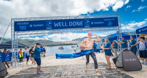 Entries are open for the Western Cape's most exciting open water swim, the Sanlam Cape Mile.  Returning to the Eikenhof Dam at the picturesque Grabouw Country Club on Sunday, 07 February 2016 entrants can choose between an exhilarating 1 mile (1.6km) and a refreshing 500m swim.  Seen here:  Danie Marais claims gold at the inaugural Sanlam Cape Mile at the picturesque Eikenhof Dam (Grabouw Country Club, Western Cape) in 2015.  Marais completed the swim in a well-deserved time of 17 minutes 41 seconds.  PHOTO CREDIT:  Volume Photography