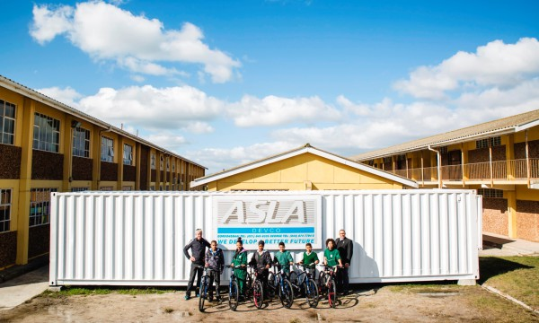 The Botriver Primary School recently took delivery of 50 bicycles (38 single speed and 12 mountain bikes with gears) compliments of the organisers of the FNB Wines2Whales (W2W) Mountain Bike (MTB) Events and the Pedal Power Association (PPA).  Seen here (from left to right):  Johan Kriegler (FNB W2W MTB Director) together with learners of the Botriver Primary School and Yusuf Haas (Principal of the Botriver Primary School).  Photo Credit:  Ewald Sadie