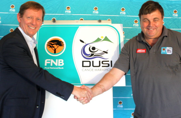 FNB's KZN Head of Acquisition, Andrew Hudson (left) and Cameron Mackenzie, Chairman of the FNB Dusi Canoe Marathon committee (right) unveil the new identify of the iconic three day canoeing event from Pietermaritzburg to Durban ahead of the 2016 edition of the race. Kyle Gilham/ Gameplan Media