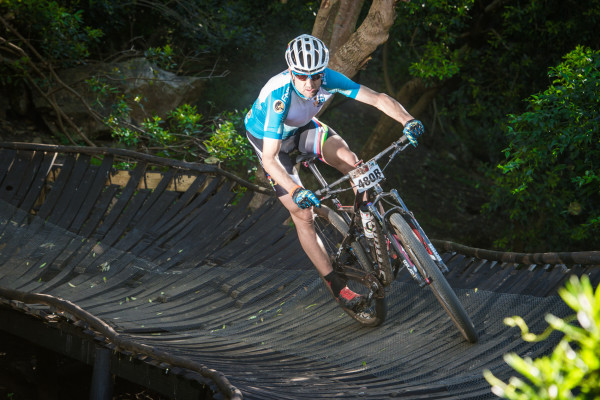 Swiss mountain biking stars Christoph Sauser and Konny Looser will team up one more time to defend their title at the 7th annual FNB Wines2Whales Mountain Bike (MTB) Race that will start at the picturesque Lourensford Wine Estate (Somerset West) on Friday, 06 November 2015.  Seen here:  Christoph Sauser in action during the 2014 FNB Wines2Whales MTB Race.  Photo Credit:  Volume Photography