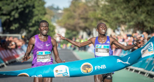 Seen here an iconic photograph of the 2015 FNB Cape Town 12 ONERUN (from left to right):  Kenya's Emmanuel Bett and Daniel Salel fought to the line at the inaugural FNB Cape Town 12 ONERUN on Sunday, 17 May 2015.  The decision, after much deliberation, going the way of Bett in a time of 33 minutes and 32 seconds (33:32).   PHOTO CREDIT:  Volume Photography