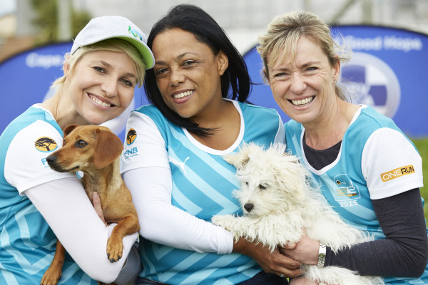 Seen here (from left to right): Television and radio personality, Liezel van der Westhuizen with her SPCA rescue Leia, Natasha Johannes (Fundraising Officer Cape Of Good Hope SPCA) and Sue Ullyett (Event Manager FNB Cape Town 12 ONERUN).  Photo Credit:  Shawn Benjamin