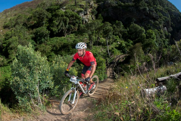 Renowned for winning the 2009 Dakar Rally, Stellenbosch based racing and rally driver, Giniel De Villiers has added the Pennypinchers Origin Of Trails two- day mountain bike stage race to his Dakar racing fitness regime. Seen here:  Giniel De Villiers in action during the 2014 FNB W2W MTB Race.  Photo Credit:  Cherie Vale / NEWSPORT MEDIA